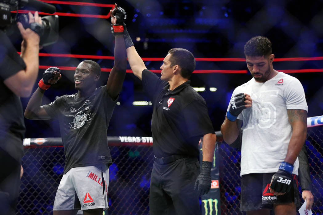 Curtis Millender, left, is announced the winner against Max Griffin in the welterweight bout during UFC 226 at T-Mobile Arena in Las Vegas, Saturday, July 7, 2018. Millender won by unanimous decis ...