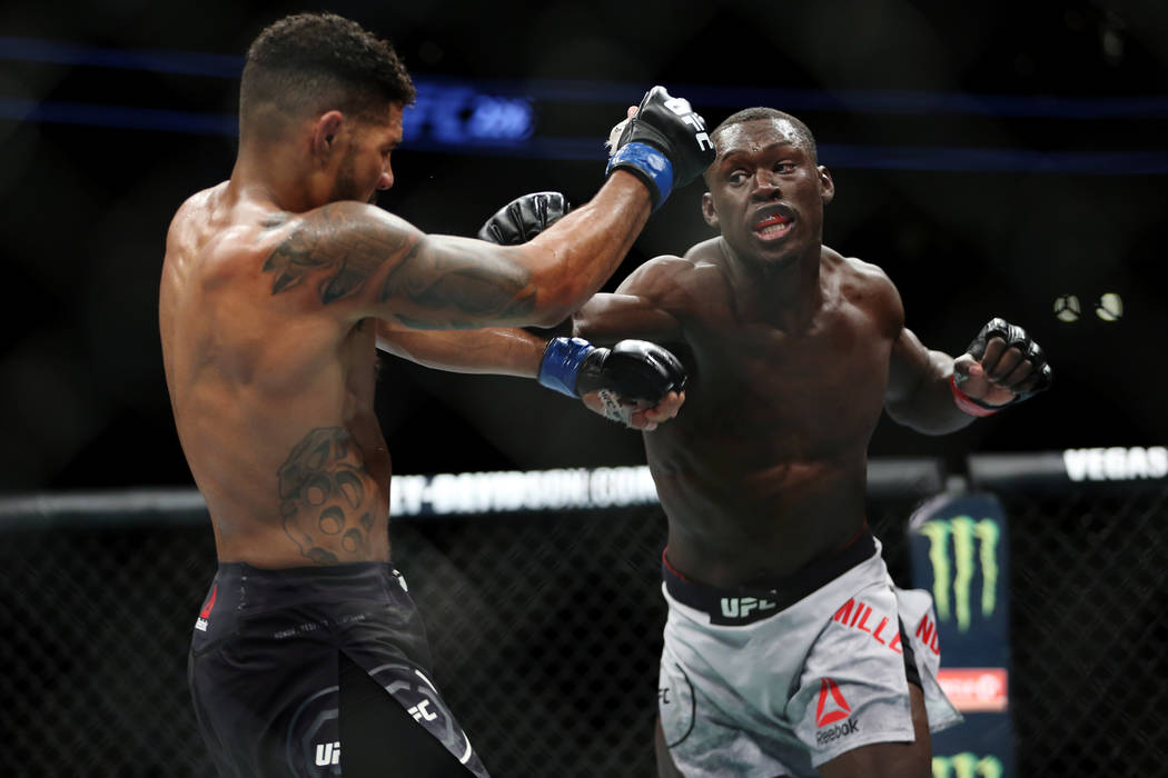Curtis Millender, right, throws a punch against Max Griffin in the welterweight bout during UFC 226 at T-Mobile Arena in Las Vegas, Saturday, July 7, 2018. Millender won by unanimous decision. Eri ...