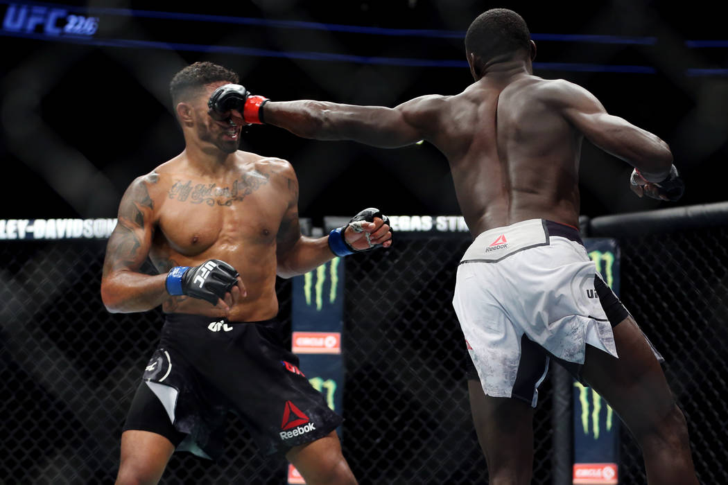 Curtis Millender, right, connects a punch against Max Griffin in the welterweight bout during UFC 226 at T-Mobile Arena in Las Vegas, Saturday, July 7, 2018. Millender won by unanimous decision. E ...