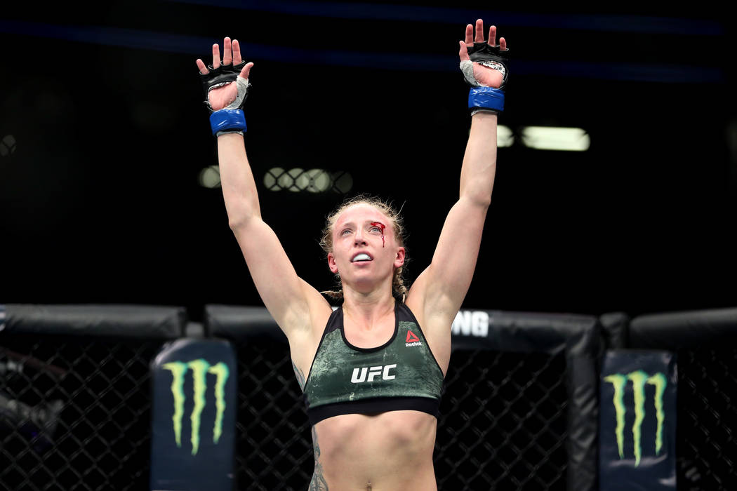 Emily Whitmire reacts at the end of the fight against Jamie Moyle in the womenÕs strawweight bout during UFC 226 at T-Mobile Arena in Las Vegas, Saturday, July 7, 2018. Whitmire won by unanim ...