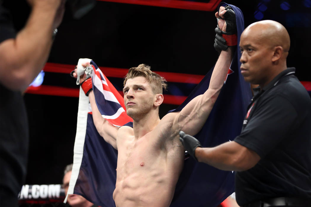 Dan Hooker is announced the winner against Gilbert Burns in the lightweight bout during UFC 226 at T-Mobile Arena in Las Vegas, Saturday, July 7, 2018. Hooker won by way of knockout in the first r ...