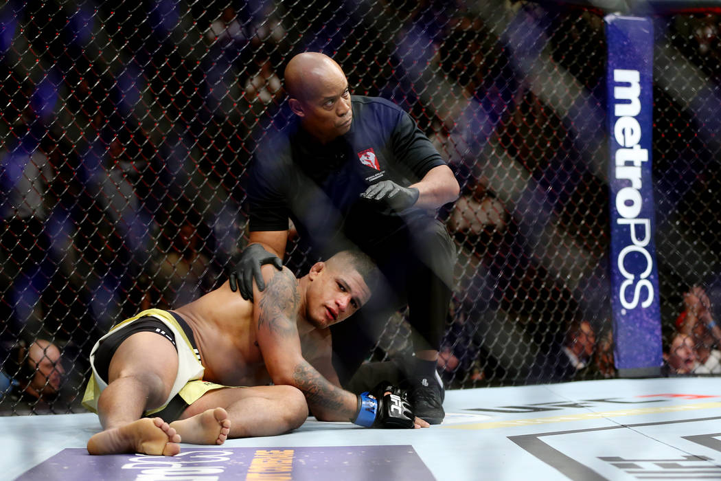Gilbert Burns is knocked out in the first round against Dan Hooker in the lightweight bout during UFC 226 at T-Mobile Arena in Las Vegas, Saturday, July 7, 2018. Erik Verduzco Las Vegas Review-Jou ...