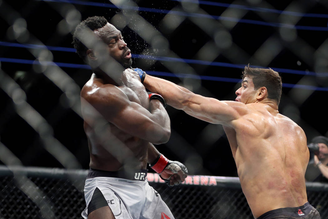 Paulo Costa, right, connects a punch against Uriah Hall in the middleweight bout during UFC 226 at T-Mobile Arena in Las Vegas, Saturday, July 7, 2018. Costa won by technical knockout in the secon ...