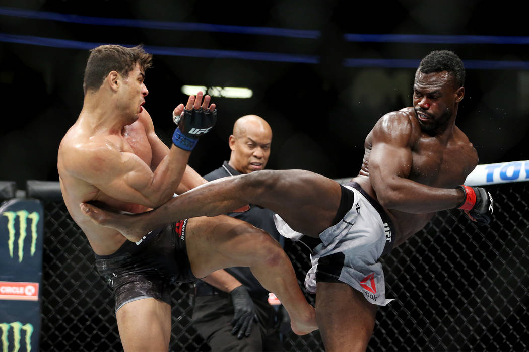Paulo Costa, left, and Uriah Hall exchange kicks in the middleweight bout during UFC 226 at T-Mobile Arena in Las Vegas, Saturday, July 7, 2018. Costa won by technical knockout in the second round ...