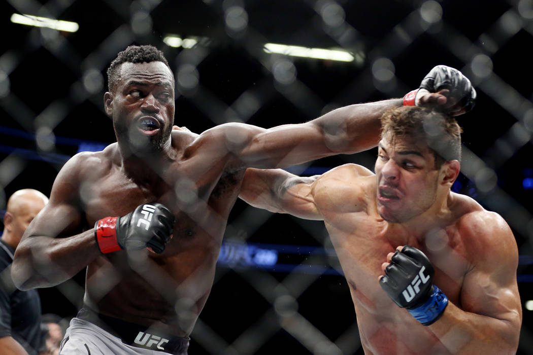 Uriah Hall, left, and Paulo Costa battle in the middleweight bout during UFC 226 at T-Mobile Arena in Las Vegas, Saturday, July 7, 2018. Costa won by technical knockout in the second round. Erik V ...