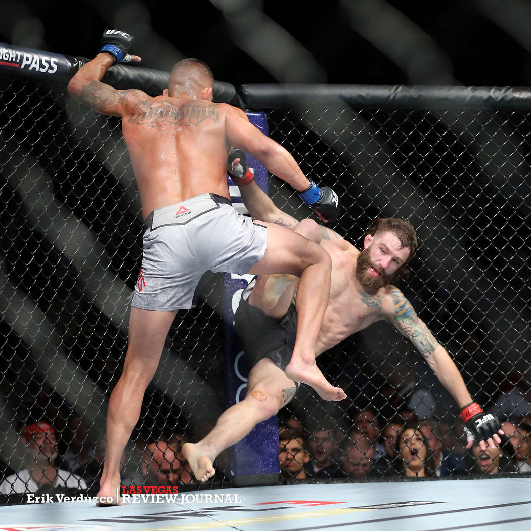Anthony Pettis, left, takes down Michael Chiesa in the lightweight bout during UFC 226 at T-Mobile Arena in Las Vegas, Saturday, July 7, 2018. Pettis won by way of submission in the second round. ...