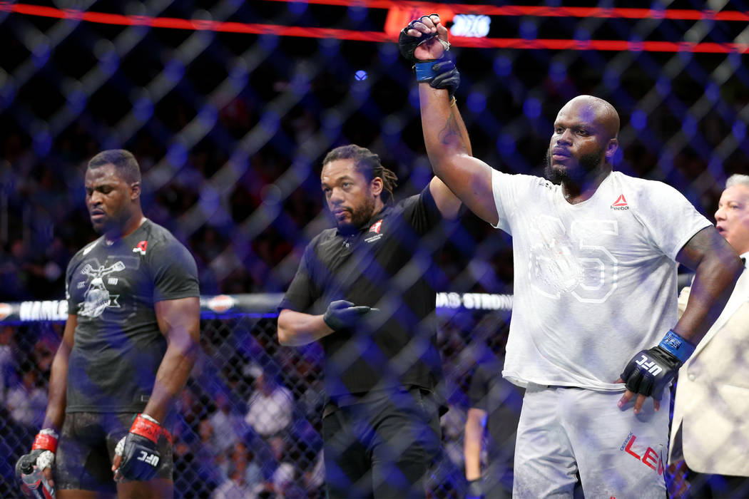 Derrick Lewis, right, is announced the winner by unanimous decision against Francis Ngannou in the heavyweight bout during UFC 226 at T-Mobile Arena in Las Vegas, Saturday, July 7, 2018. Erik Verd ...