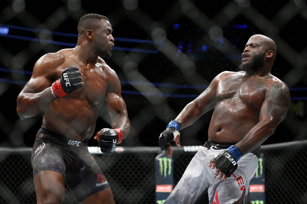 Francis Ngannou, left, battles Derrick Lewis in the heavyweight bout during UFC 226 at T-Mobile Arena in Las Vegas, Saturday, July 7, 2018. Lewis won by unanimous decision. Erik Verduzco Las Vegas ...