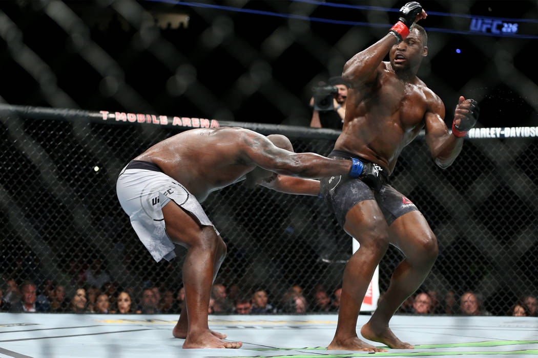 Derrick Lewis, left, battles Francis Ngannou in the heavyweight bout during UFC 226 at T-Mobile Arena in Las Vegas, Saturday, July 7, 2018. Lewis won by unanimous decision. Erik Verduzco Las Vegas ...