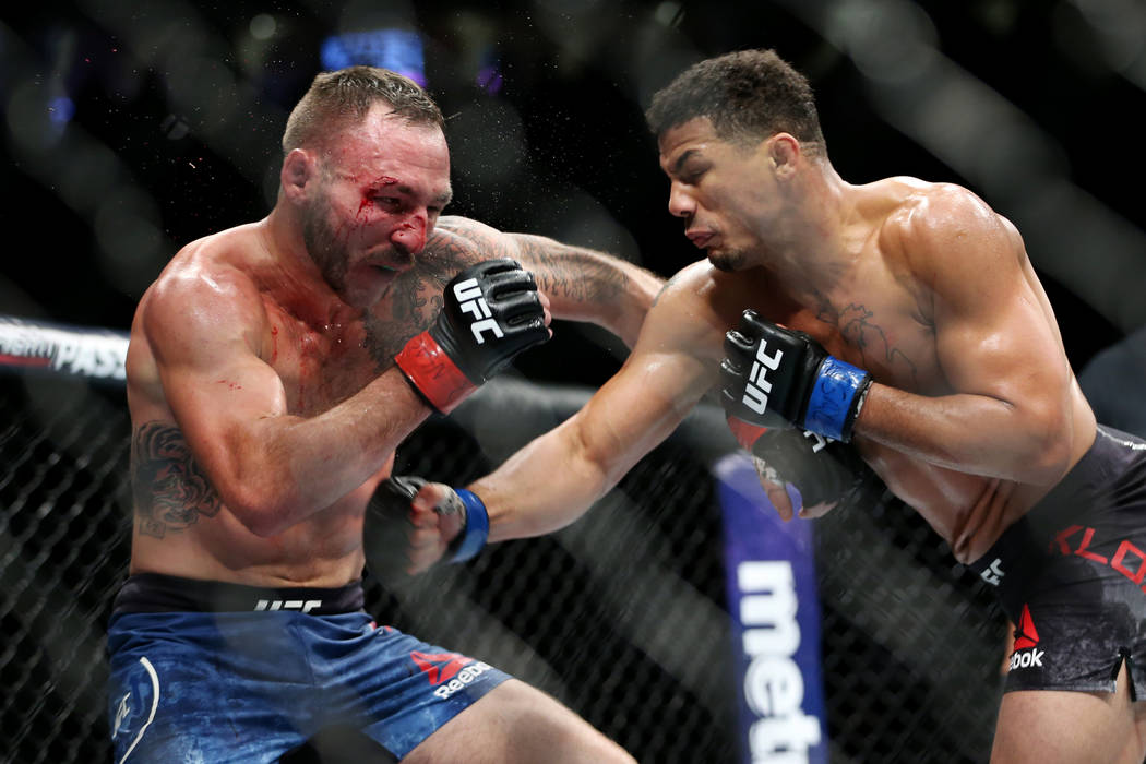 Drakkar Klose, right, connects a punch against Lando Vannata in the lightweight bout during UFC 226 at T-Mobile Arena in Las Vegas, Saturday, July 7, 2018. Klose won by unanimous decision. Erik Ve ...