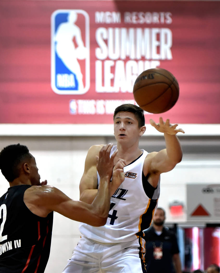Utah Jazz guard Grayson Allen, right, passes the ball against Portland Trail Blazer guard Wade Baldwin IV during an NBA summer league basketball game Saturday, July 7, 2018, in Las Vegas. David Be ...