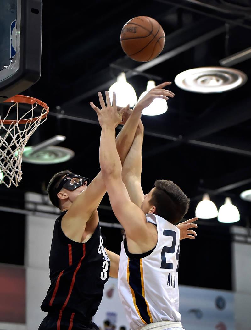 Portland Trail Blazer center Zach Collins, left, blocks the ball from Utah Jazz guard Grayson Allen during an NBA summer league basketball game Saturday, July 7, 2018, in Las Vegas. David Becker/L ...