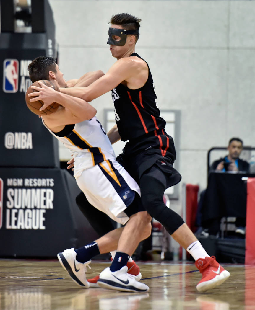 Portland Trail Blazer center Zach Collins, right, attempts to steal the ball from Utah Jazz guard Grayson Allen during an NBA summer league basketball game Saturday, July 7, 2018, in Las Vegas. Da ...