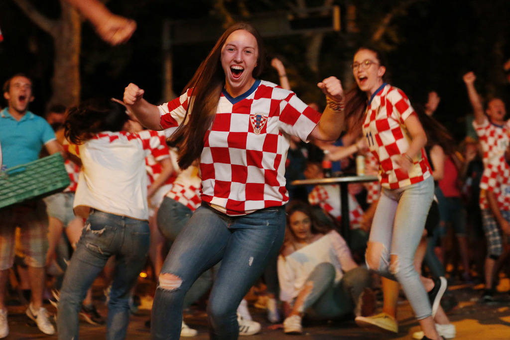 Bosnian Croats, in the streets of Southern-Bosnian town of Mostar, cheer while watching the quarter-final match of the FIFA 2018 World Championship between Croatia and Russia, in Mostar, 140 kilom ...