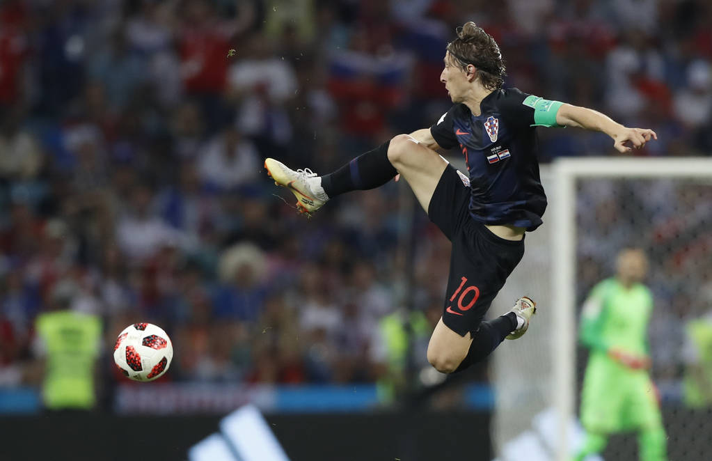 Croatia's Luka Modric jumps for the ball during the quarterfinal match between Russia and Croatia at the 2018 soccer World Cup in the Fisht Stadium, in Sochi, Russia, Saturday, July 7, 2018. (AP P ...