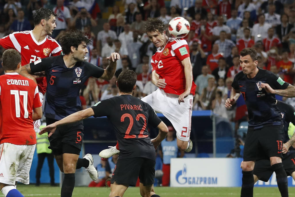 Russia's Mario Fernandes , centre, scores his side's second goal during the quarterfinal match between Russia and Croatia at the 2018 soccer World Cup in the Fisht Stadium, in Sochi, Russia, Satur ...