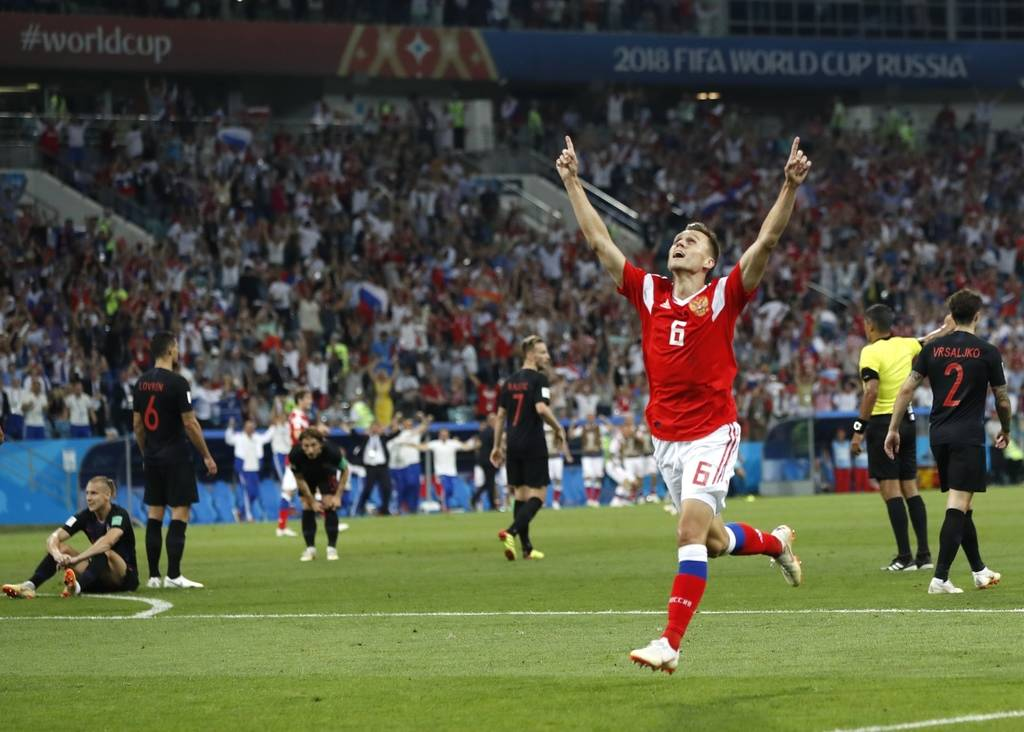 Russia's Denis Cheryshev celebrates after scoring his side's first goal during the quarterfinal match between Russia and Croatia at the 2018 soccer World Cup in the Fisht Stadium, in Sochi, Russia ...