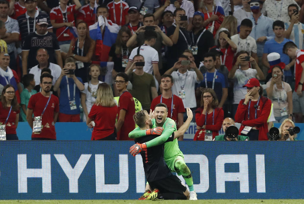 Croatia goalkeeper Danijel Subasic, right, celebrates Ivan Rakitic at the end of the quarterfinal match between Russia and Croatia at the 2018 soccer World Cup in the Fisht Stadium, in Sochi, Russ ...