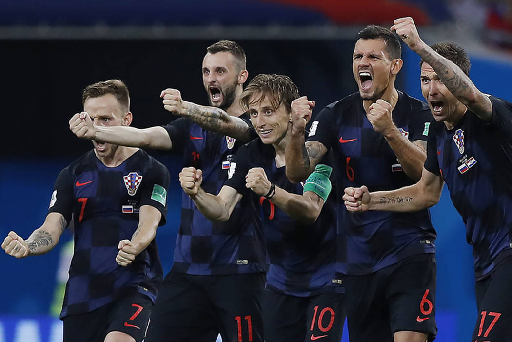 Croatia national soccer team players celebrate after a penalty is saved in a shootout during the quarterfinal match between Russia and Croatia at the 2018 soccer World Cup in the Fisht Stadium, in ...