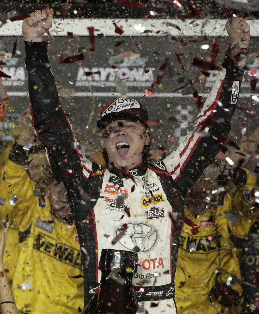 Erik Jones celebrates in Victory Lane after winning the NASCAR Cup Series auto race at Daytona International Speedway, Saturday, July 7, 2018, in Daytona Beach, Fla. (AP Photo/John Raoux)