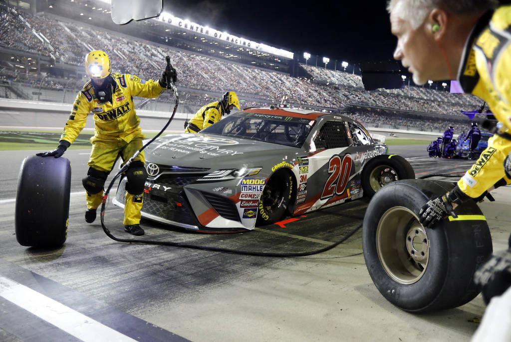 Erik Jones makes a pit stop during the NASCAR Cup Series auto race at Daytona International Speedway, Saturday, July 7, 2018, in Daytona Beach, Fla. Jones won the race. (AP Photo/Terry Renna)