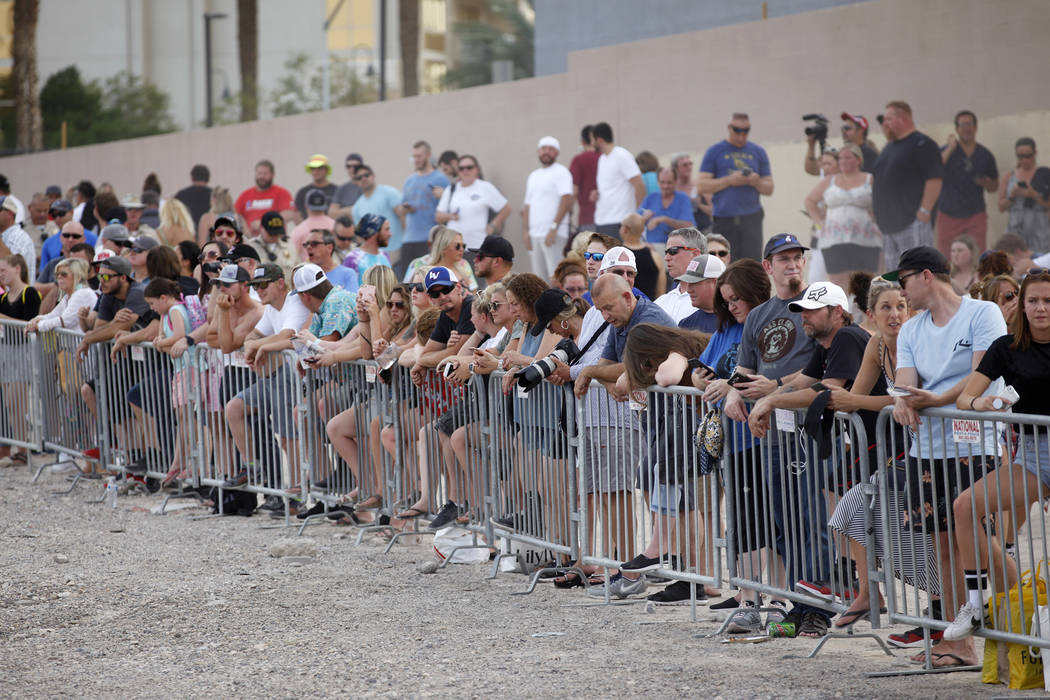 Attendees wait for the show at the Evel Live event where Travis Pastrana attempted to exceed three of Evel Knievel's famous jumps in a lot behind Planet Hollywood hotel-resort in Las Vegas, Sunday ...