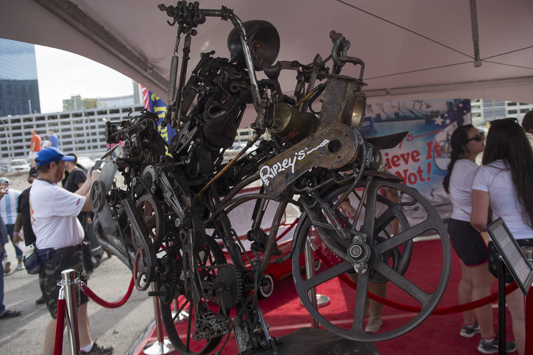 A bike made by Andrew Smith of Lehi, Utah is created out of recycled items on display at the Ripley's Believe It Or Not exhibit at the Evel Live event where Travis Pastrana attempted to exceed thr ...