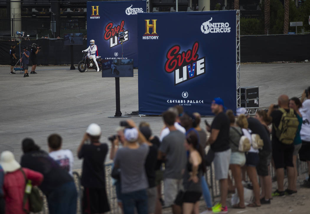 Travis Pastrana right before his second jump over 16 greyhound buses on an Indian Scout FTR750 motorcycle at the Evel Live event in a lot behind Planet Hollywood hotel-resort in Las Vegas, Sunday, ...