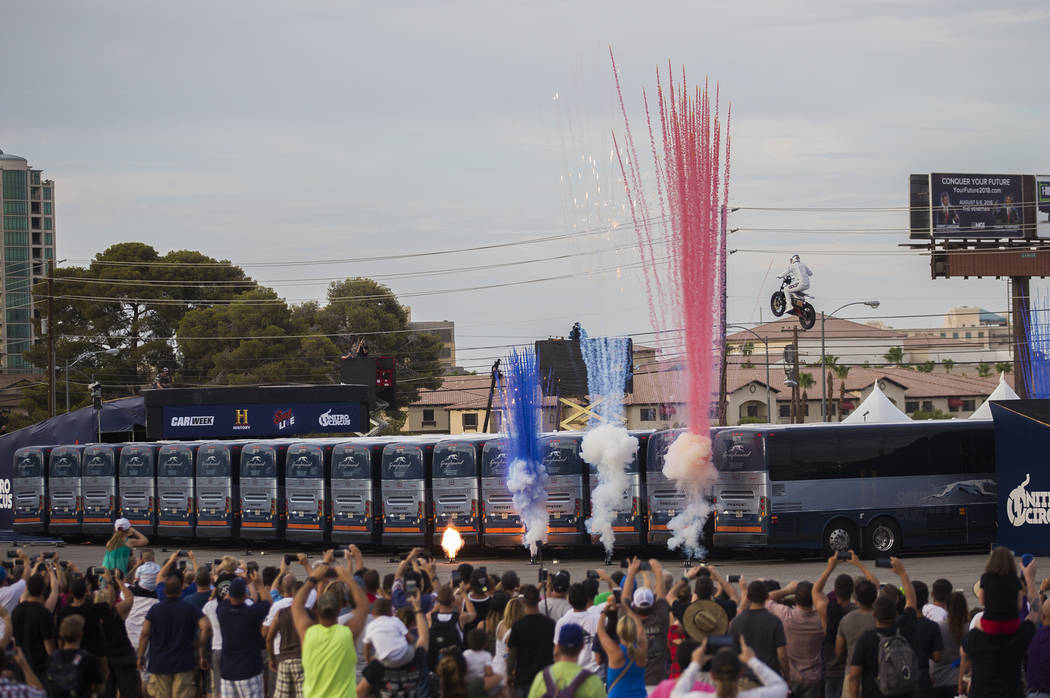 Travis Pastrana jumps over 16 greyhound buses on an Indian Scout FTR750 motorcycle at the Evel Live event in a lot behind Planet Hollywood hotel-resort in Las Vegas, Sunday, July 8, 2018. The show ...