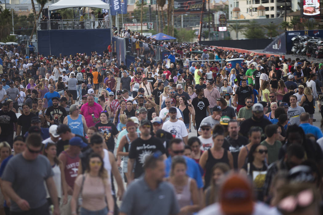 Attendees leave the Evel Live event after Travis Pastrana's successful second jump in a lot behind Planet Hollywood hotel-resort in Las Vegas, Sunday, July 8, 2018. The show was produced by the Hi ...