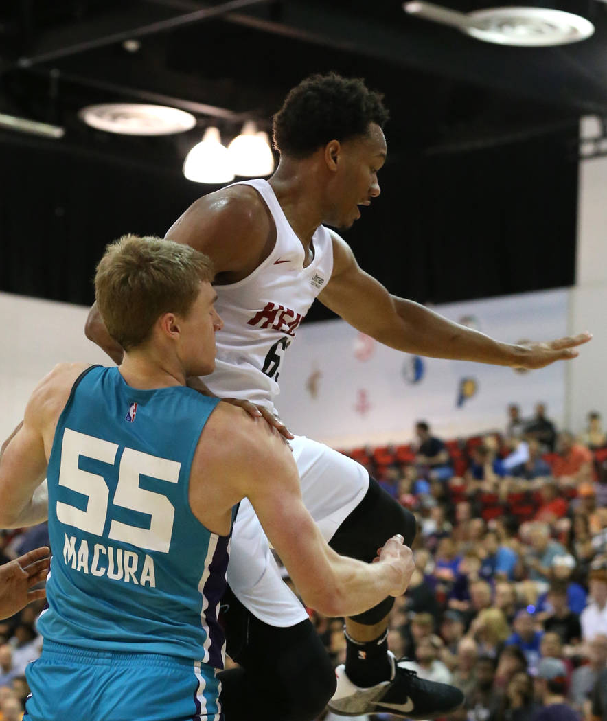 The Miami Heat guard Rashad Vaughn (65) is fouled by the Charlotte Hornets' guard J.P. Macura during an NBA summer league basketball game at the Cox Pavilion on Sunday, July, 2018, in Las Vegas. B ...