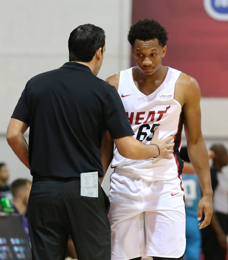 The Miami Heat guard Rashad Vaughn (65) listens to Summer League head coach Eric Glass during an NBA summer league basketball game against the Charlotte Hornets at the Cox Pavilion on Sunday, July ...