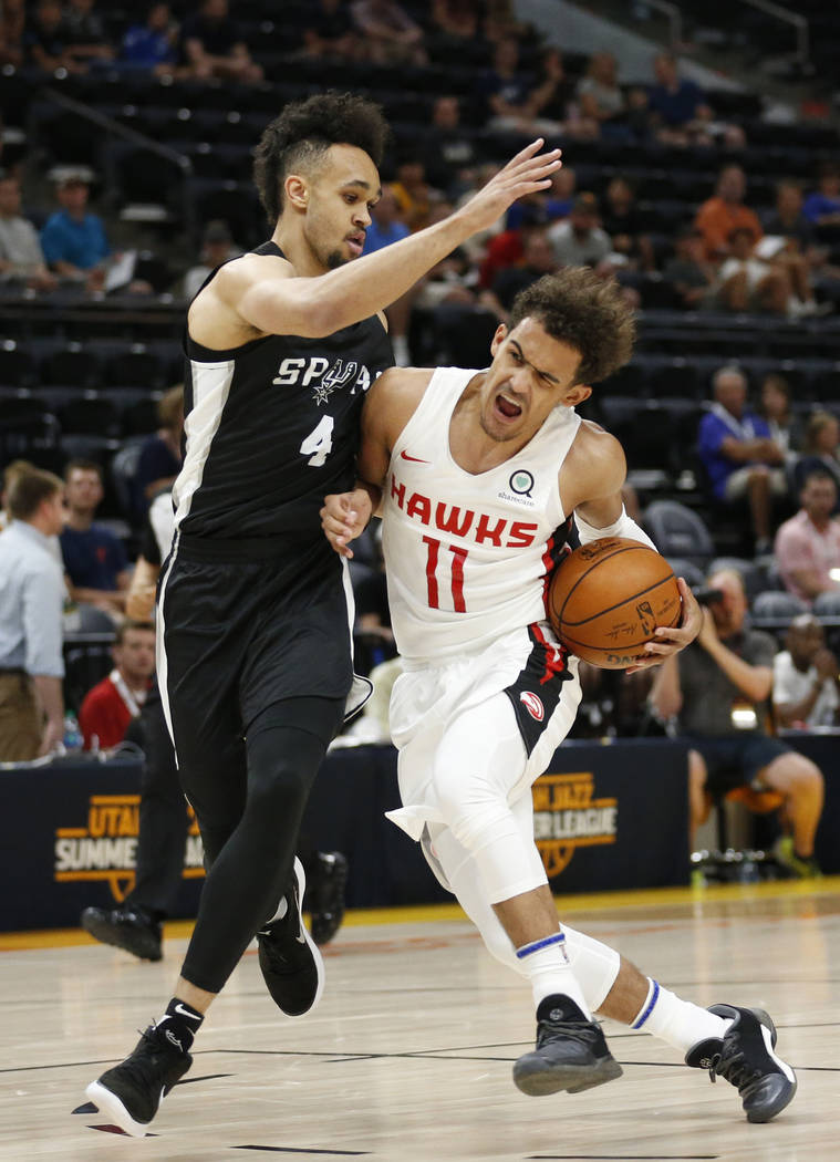San Antonio Spurs guard Derrick White (4) guards Atlanta Hawks guard Trae Young (11) during the first half of an NBA summer league basketball game Tuesday, July 3, 2018, in Salt Lake City. (AP Pho ...