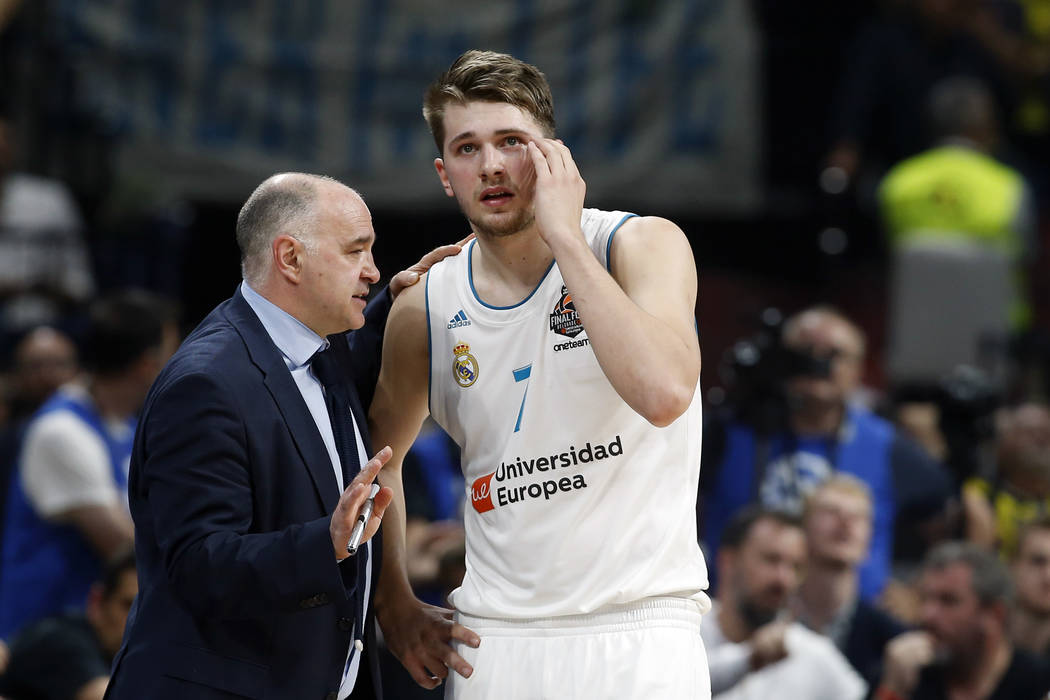 9393eeac727 Real Madrid head coach Pablo Laso gives instructions to Real Madrid s Luka  Doncic during their Final