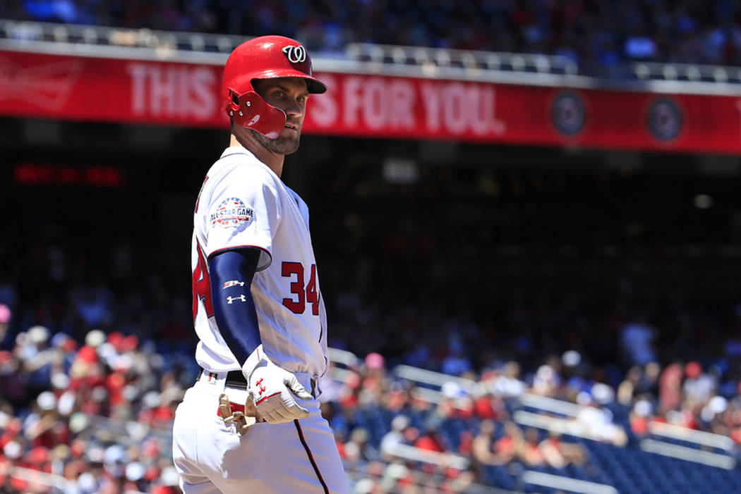 Washington Nationals' Bryce Harper (34) looks at the home plate umpire after being called out during the first inning of a baseball game against the Miami Marlins in Washington, Sunday, July 8, 20 ...