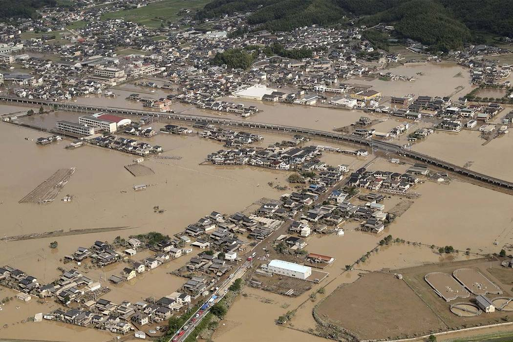 This photo shows an submerged housing area in Kurashiki, Okayama prefecture, western Japan Monday, July 9, 2018. People prepared for risky search and cleanup efforts in southwestern Japan on Monda ...