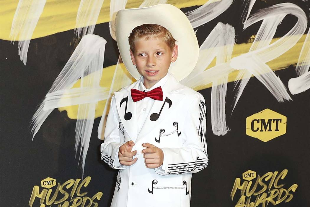 In this June 6, 2018, file photo, Mason Ramsey arrives at the CMT Music Awards at the Bridgestone Arena in Nashville, Tenn. Ramsey, who went viral online in a video of him singing and yodeling in ...