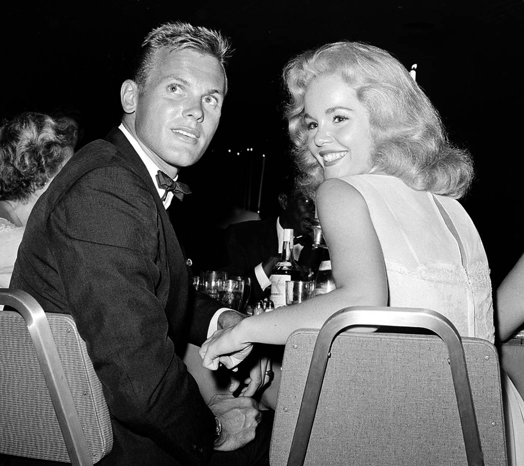 Actor Tab Hunter, left, with actress Tuesday Weld at a dinner reception in Los Angeles, July 27, 1959. Hunter, the blond actor and singer who was the heartthrob of millions of teenage girls in the ...