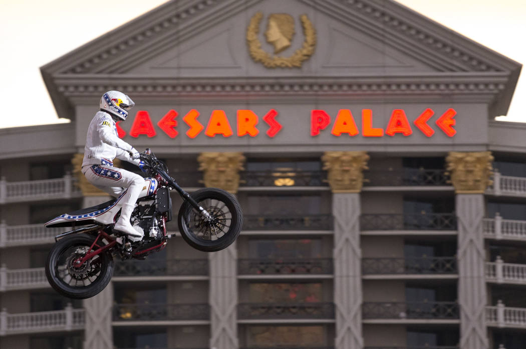 "Travis Pastrana jumps over the fountains at Caesars Palace on an Indian Scout FTR750 motorcycle during ""Evel Live,"" a three-hour live tribute show to stuntman Evel Kneivel, in Las Vegas ..."