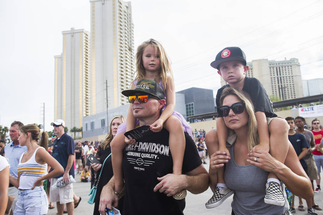 Jack Stubbs holds his daughter, Tatum Stubbs, 4, as his wife Samantha Stubbs holds their son, Kellen Stubbs, 6, to get a better view at the Evel Live event where Travis Pastrana attempted to excee ...