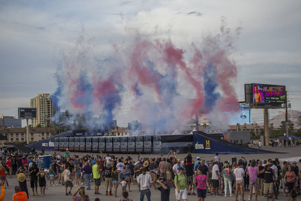 The smoke from fireworks remains after Travis Pastrana jumped over 16 greyhound buses on an Indian Scout FTR750 motorcycle at the Evel Live event in a lot behind Planet Hollywood hotel-resort in L ...