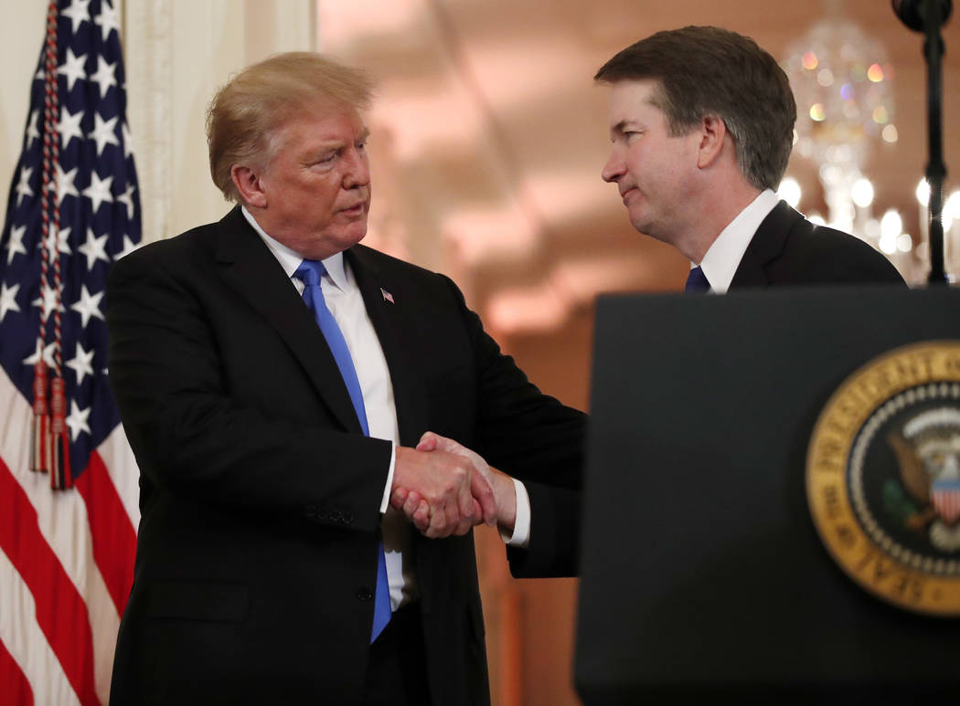 President Donald Trump shakes hands with Judge Brett Kavanaugh his Supreme Court nominee, in the East Room of the White House, Monday, July 9, 2018, in Washington. (AP Photo/Alex Brandon)