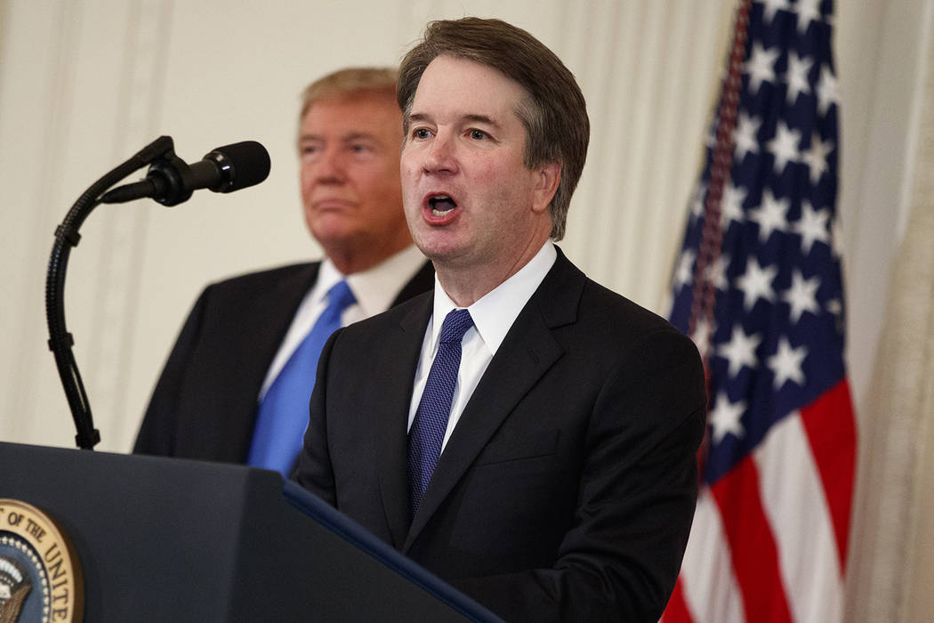 President Donald Trump listens as Brett Kavanaugh, his Supreme Court nominee, speaks during an event in the East Room of the White House, Monday, July 9, 2018, in Washington. (AP Photo/Evan Vucci)