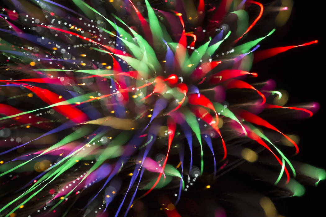 Fireworks explode from a launchpad behind the Moapa Paiute Travel Plaza firework store during Fourth of July festivities in Moapa, Nevada on Wednesday, July 4, 2018. Richard Brian Las Vegas Review ...