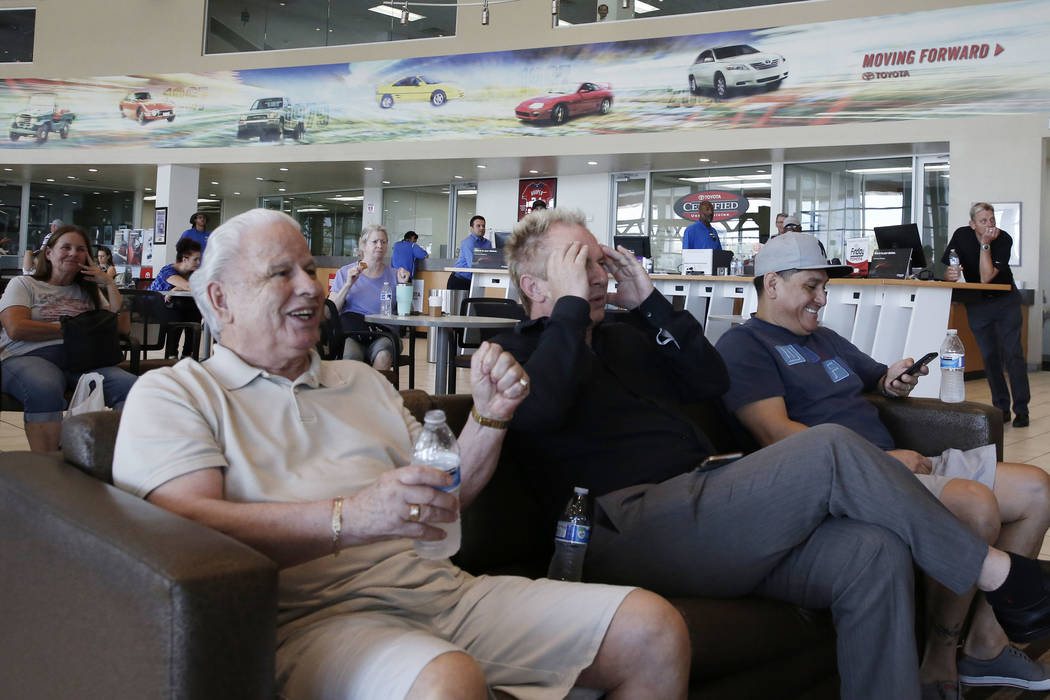 Findlay Toyota General Manager John Barr, center, reacts to a play as he watches a World Cup semifinal match between Croatia and England on a TV at Findlay Toyota on Wednesday, July 11, 2018, in H ...
