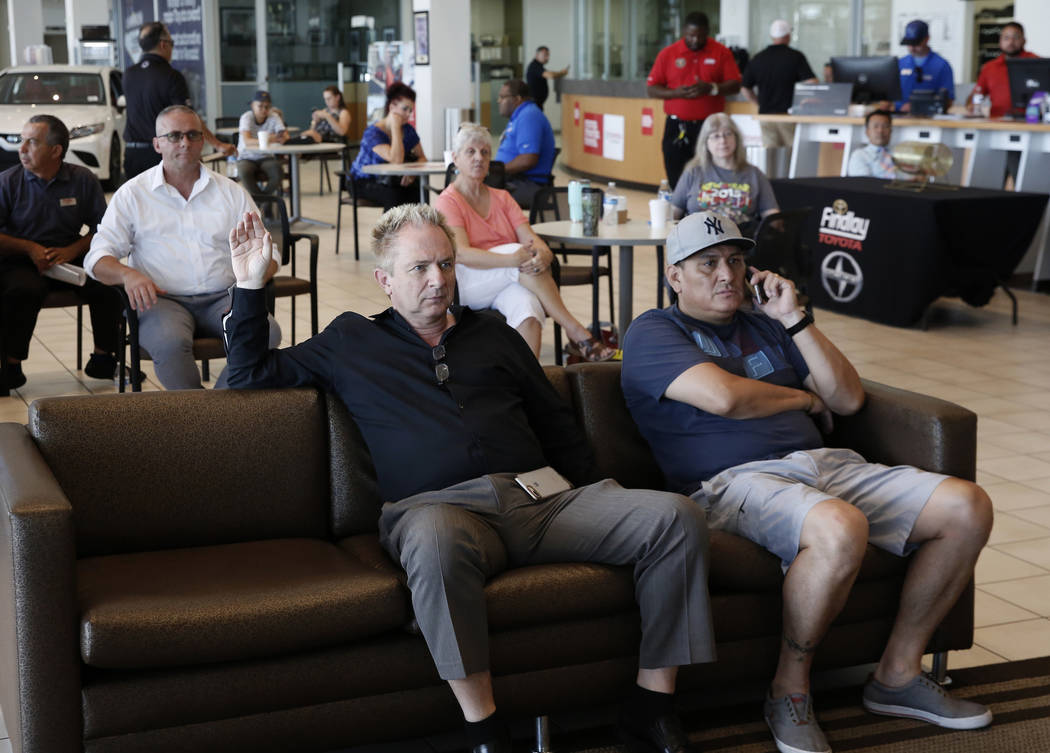 Findlay Toyota General Manager John Barr, left, watches a World Cup semifinal match between Croatia and England on a TV at Findlay Toyota on Wednesday, July 11, 2018, in Henderson. Bizuayehu Tesfa ...
