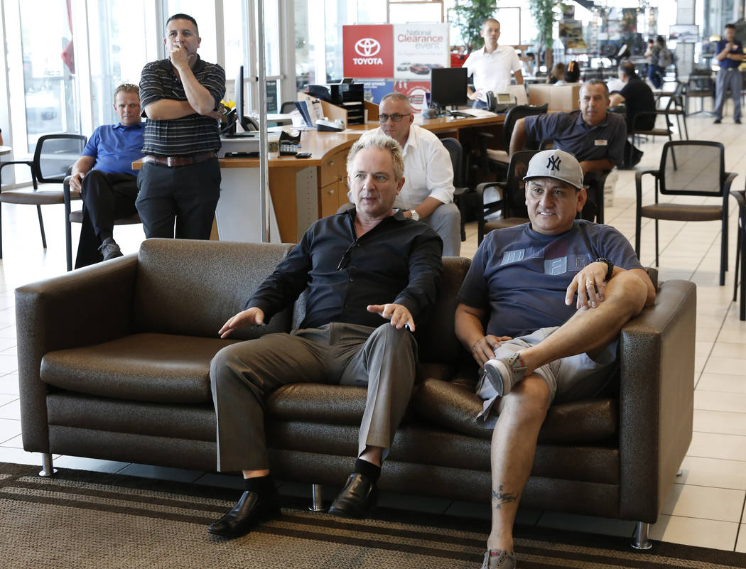 Findlay Toyota General Manager John Barr, left, reacts to a play as he watches a World Cup semifinal match between Croatia and England on a TV at Findlay Toyota on Wednesday, July 11, 2018, in Hen ...