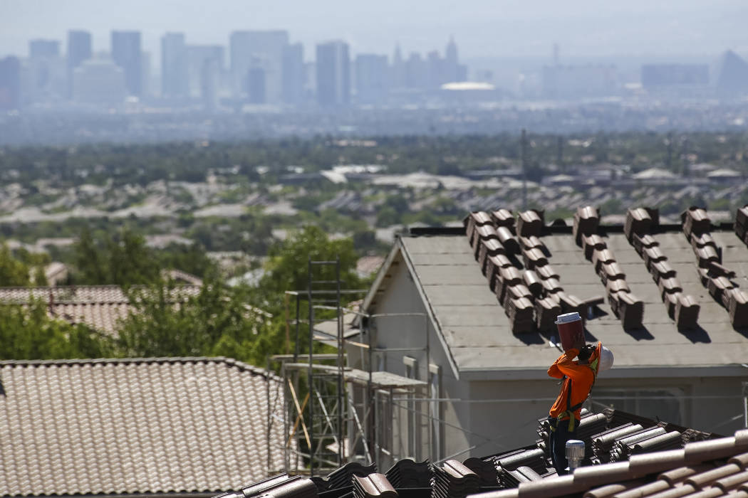 A roofer quenches his thirst while doing tile work on a house in the master-planned community of Summerlin in Las Vegas on Saturday, June 30, 2018. Richard Brian Las Vegas Review-Journal @vegaspho ...