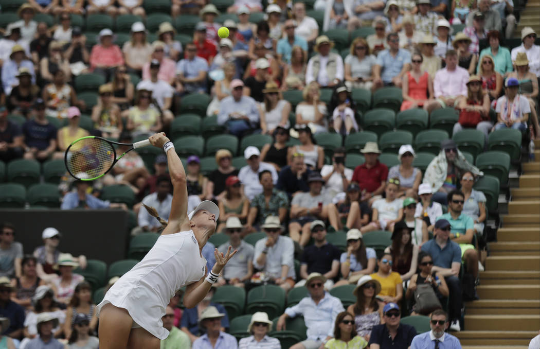 Kiki Bertens of the Netherlands serves to Karolina Pliskova of the Czech Republic during their women's singles match on the seventh day at the Wimbledon Tennis Championships in London, Monday July ...