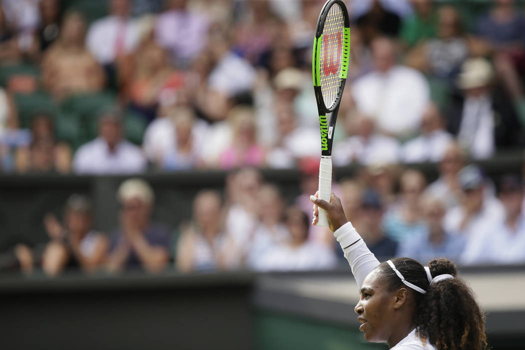 Serena Williams of the United States returns the ball to Russia's Evgeniya Rodina during their women's singles match, on day seven of the Wimbledon Tennis Championships, in London, Monday July 9, ...
